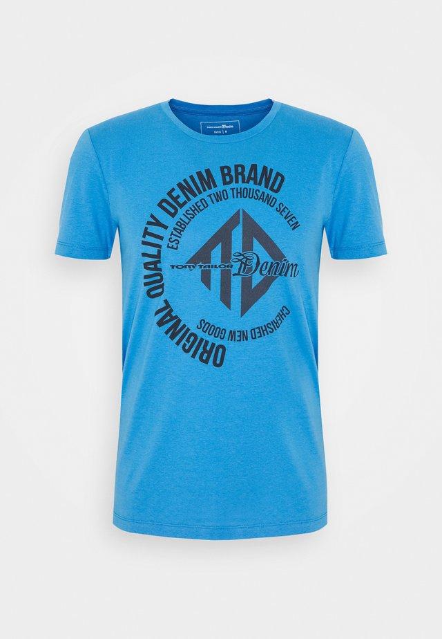 COINPRINT - T-shirts print - water sport blue