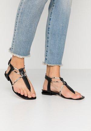 GRETA - T-bar sandals - nero/bianco