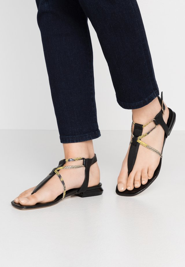 GRETA - T-bar sandals - giallo/nero