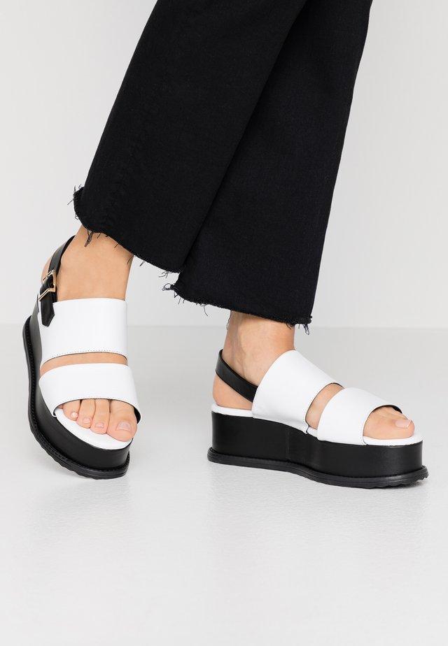 MAURITIUS - Korkeakorkoiset sandaalit - bianco/nero