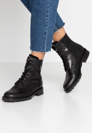 GISELLE - Lace-up ankle boots - nero