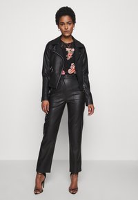 Topshop Tall - STRAIGHT - Trousers - black - 1