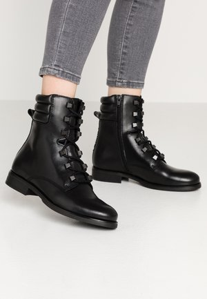 PIN LOGO LACE UP BOOT - Lace-up ankle boots - black