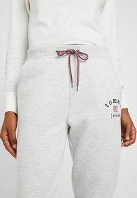 Tommy Jeans - SWEATPANT - Tracksuit bottoms - pale grey - 5