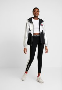 Tommy Jeans - METALLIC BLOCK - Leggings - black - 1