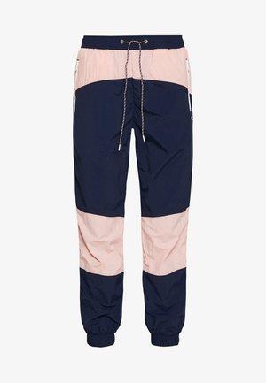COLORBLOCK  - Tracksuit bottoms - black iris/pink icing