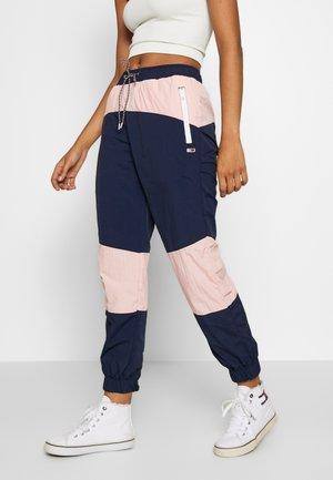 COLORBLOCK  - Teplákové kalhoty - black iris/pink icing