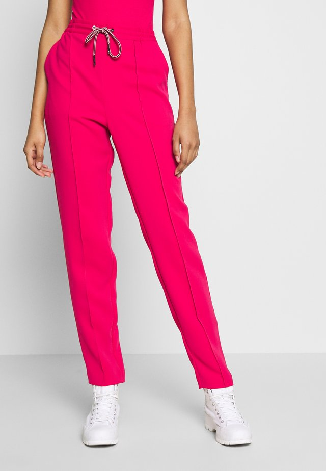 SMART JOGGER - Tracksuit bottoms - blush red