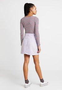 Tommy Jeans - SOLID CARPENTER SKIRT - Áčková sukně - pastel lilac - 2