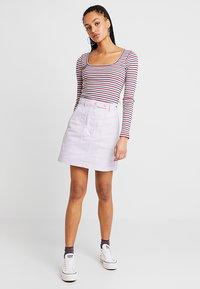 Tommy Jeans - SOLID CARPENTER SKIRT - Áčková sukně - pastel lilac - 1
