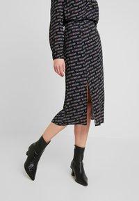 Tommy Jeans - OUTLINE PRINT SKIRT - A-line skirt - tommy black - 0