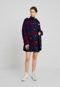 Tommy Jeans - FITTED DRESS - Pouzdrové šaty - black iris - 2