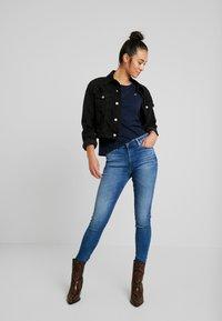 Tommy Jeans - TJW SOFT JERSEY LONGSLEEVE - Long sleeved top - black iris - 1