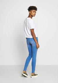 Tommy Jeans - TJW SLEEVE DETAIL LOGO TEE - Print T-shirt - white - 2