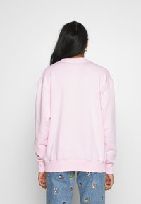 Tommy Jeans - TJW LOONEY TUNES CREW - Mikina - romantic pink - 2