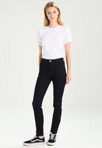 Tommy Jeans - HIGH RISE SANTANA - Jeans Skinny Fit - black denim - 1
