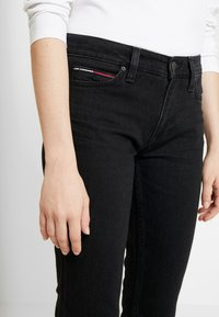 Tommy Jeans - MID RISE - Bootcut jeans - black denim - 3