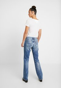 Tommy Jeans - MID RISE BOOTCUT - Bootcut jeans - light blue denim - 2