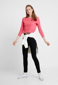 Tommy Jeans - HIGH RISE - Jeans Skinny Fit - black denim - 1