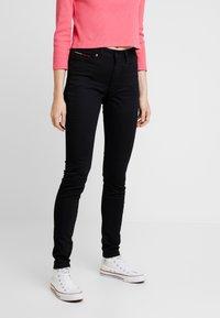 Tommy Jeans - HIGH RISE - Jeans Skinny Fit - black denim - 0