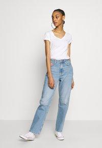 Tommy Jeans - HARPER STRGHT - Straight leg jeans - light blue denim - 1