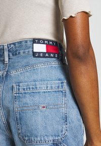 Tommy Jeans - HIGH RISE CARPENTER - Relaxed fit jeans - light-blue denim - 4