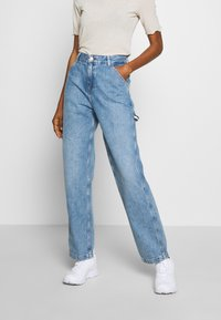 Tommy Jeans - HIGH RISE CARPENTER - Relaxed fit jeans - light-blue denim - 0