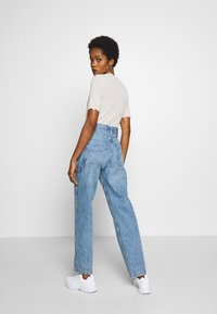Tommy Jeans - HIGH RISE CARPENTER - Relaxed fit jeans - light-blue denim - 2