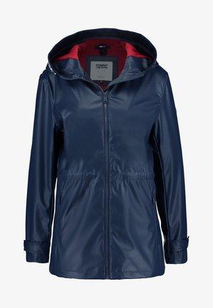 TAPE DETAIL RAIN COAT - Waterproof jacket - black iris