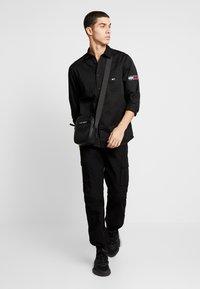 Tommy Jeans - POCKET - Koszula - black - 1