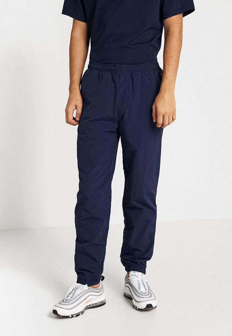 Tommy Jeans - TJM JOG PANT - Spodnie treningowe - blue