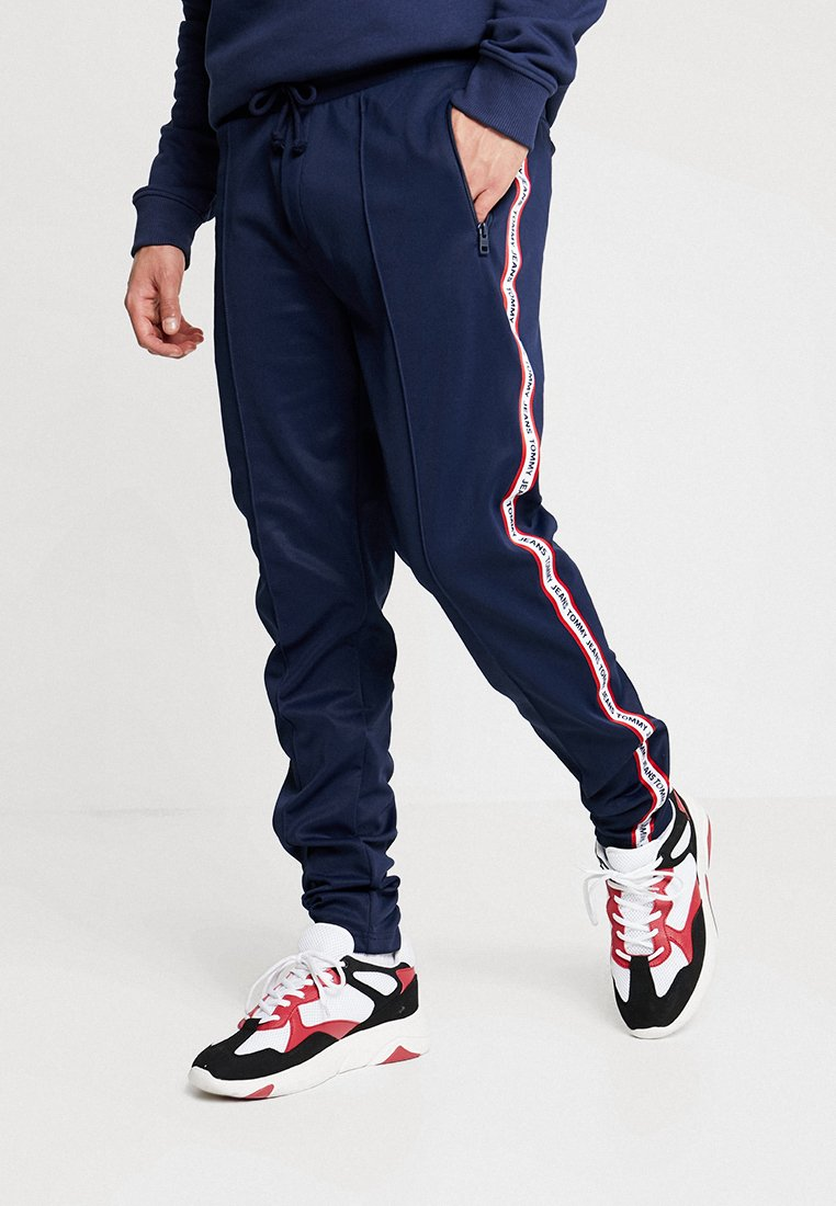 Tommy Jeans - TJM TRACK PANT - Tracksuit bottoms - blue