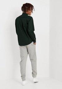 Tommy Jeans - CLASSICS - Pantaloni sportivi - grey - 2