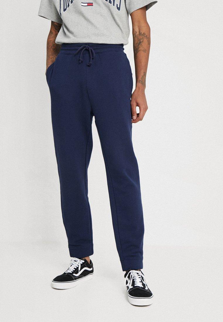 Tommy Jeans - CLASSICS - Tracksuit bottoms - blue