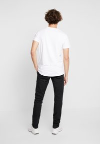 Tommy Jeans - SCANTON PANT - Chino kalhoty - black - 2