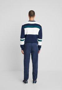 Tommy Jeans - CUFFED PANT - Spodnie materiałowe - black iris - 2