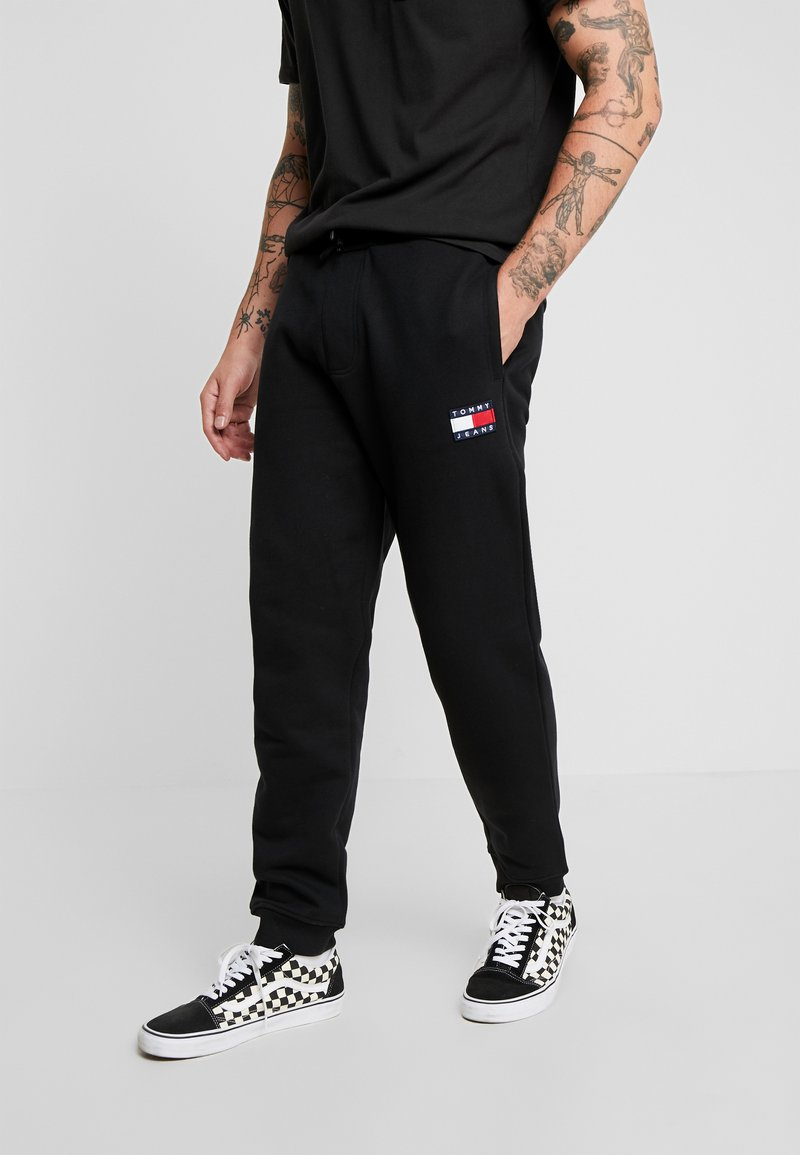 Tommy Jeans - BADGE PANT - Tracksuit bottoms - black