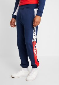 Tommy Jeans - TJM COLORBLOCK SWEATPANT  - Pantalon de survêtement - black iris - 0