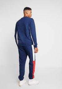 Tommy Jeans - TJM COLORBLOCK SWEATPANT  - Pantalon de survêtement - black iris - 2