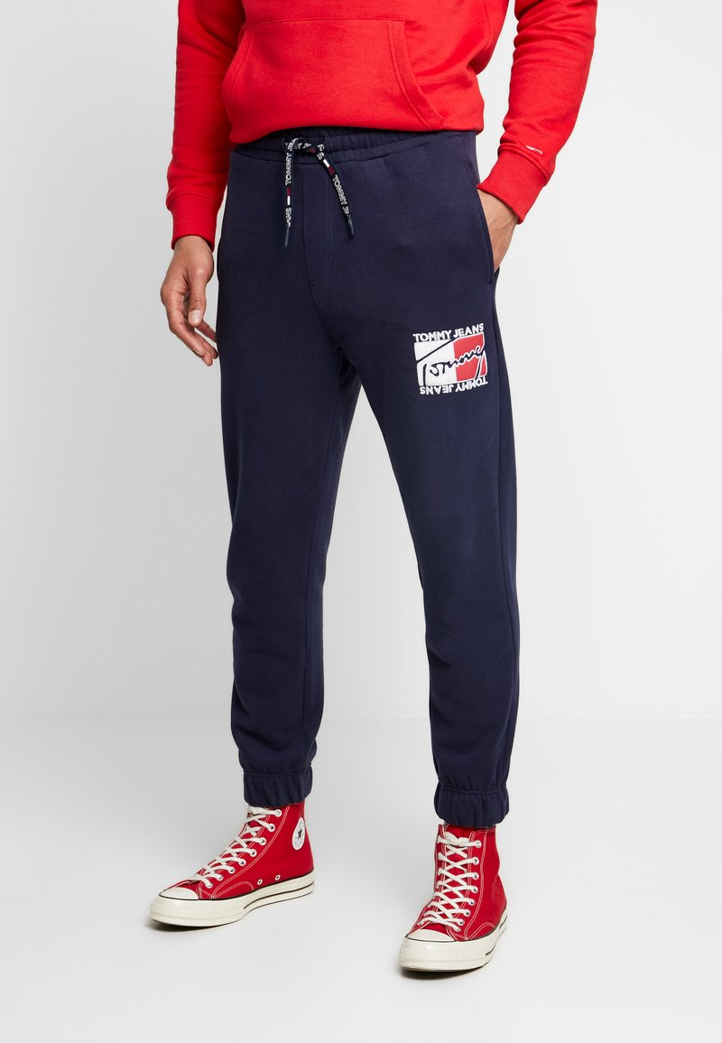 Tommy Jeans - GRAPHIC  - Tracksuit bottoms - dark blue