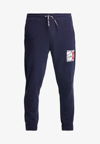 Tommy Jeans - GRAPHIC  - Tracksuit bottoms - dark blue - 4