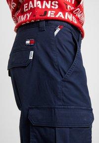 Tommy Jeans - DOBBY PANT - Pantalones cargo - black iris - 4