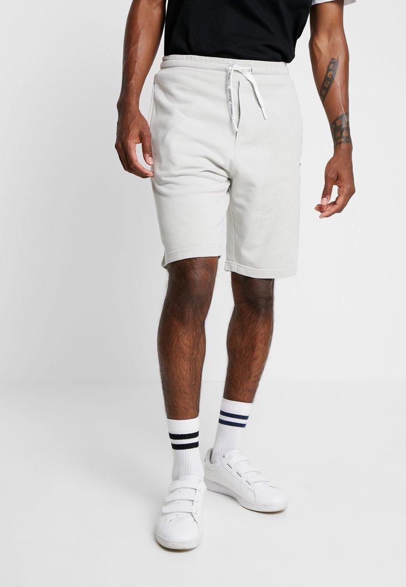 Tommy Jeans - WASHED - Tracksuit bottoms - grey/light grey