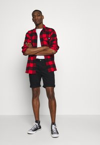 Tommy Jeans - ESSENTIAL - Shorts - black - 1