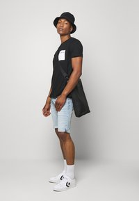 Tommy Jeans - RONNIERELAXED - Denim shorts - light-blue denim - 1