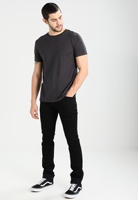 Tommy Jeans - SCANTON - Slim fit jeans - black comfort - 1