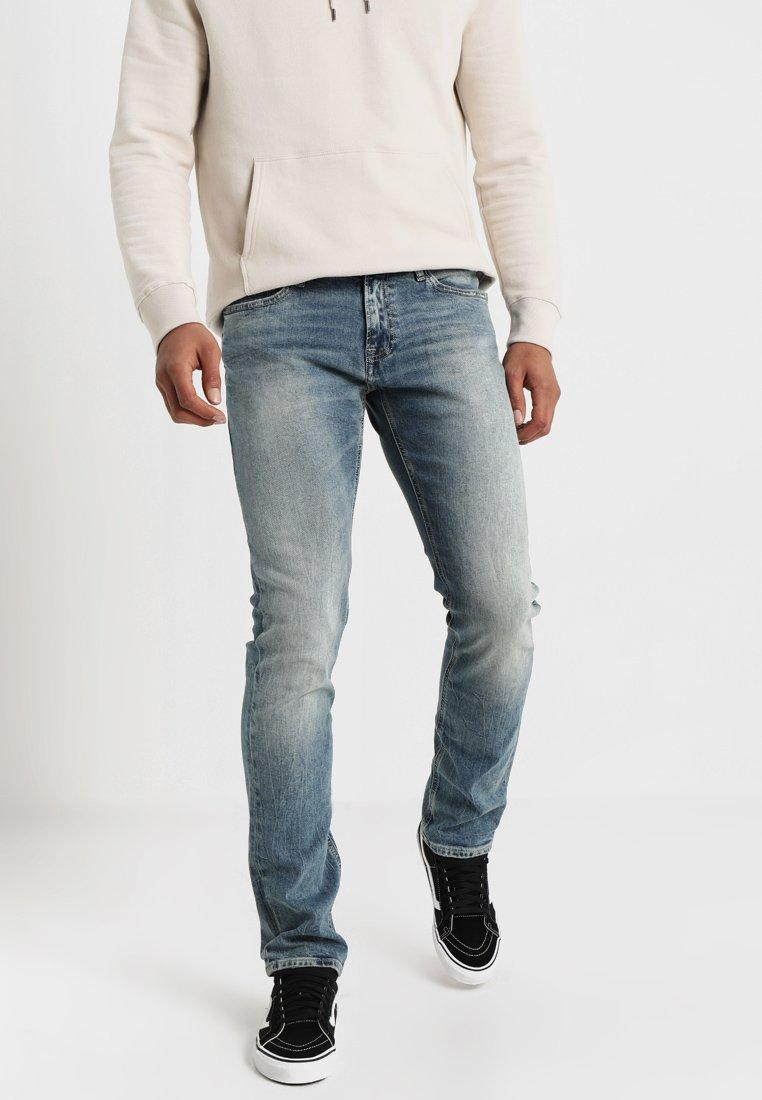 Tommy Jeans - TAPERED STEVE - Jeans Slim Fit - blue denim