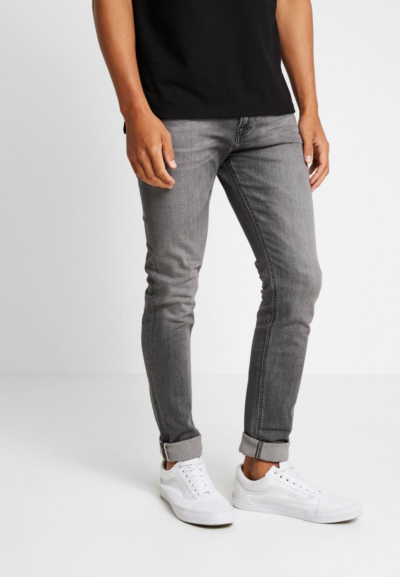 Tommy Jeans - SKINNY SIMON ASTNGY - Slim fit jeans - black denim