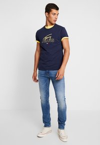 Tommy Jeans - SCANTON HERITAGE  - Jeans slim fit - blue denim - 1