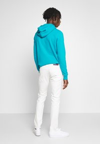 Tommy Jeans - SCANTON HERITAGE - Jeansy Slim Fit - mars white com - 2